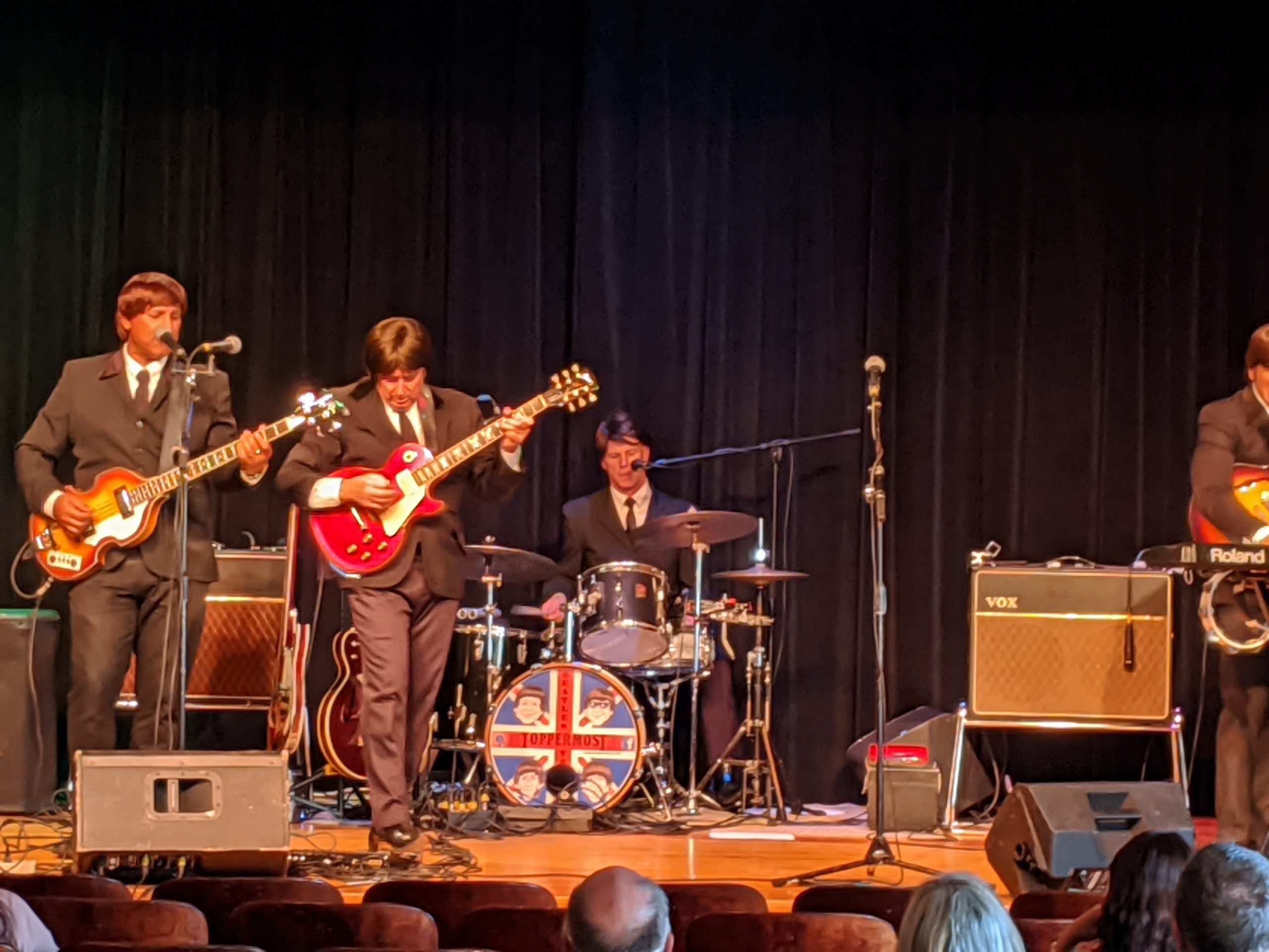 Photo of band Toppermost performing.